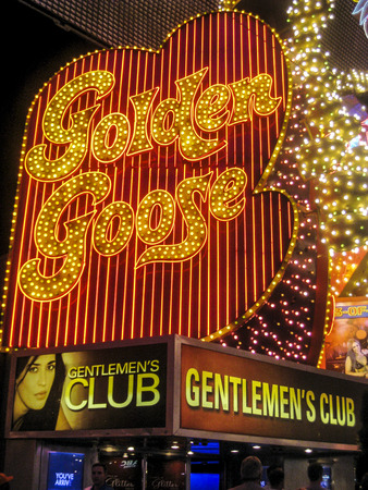LAS VEGAS, USA - MARCH 23, 2014 : golden goose gentlemens club at Fremont Street in Las Vegas, USA. The Fremont Street is a pedestrian mall and attraction in downtown Las Vegas Editorial
