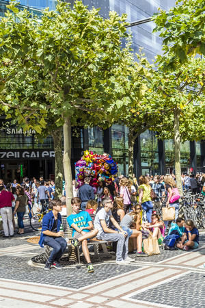 paveway: FRANKFURT, GERMANY - AUGUST 9, 2014: people walk along the Zeil in Midday  in Frankfurt, Germany. Since the 19th century it is of the most famous and busiest shopping streets in Germany. Editorial