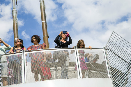FRANKFURT, GERMANY - AUGUST 9, 2014: people take pictures of skyline in Frankfurt,Germany. The platform on Zeil-Galerie offers the best free of charge overview in town. Editorial