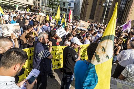 prisoner of war: FRANKFURT, GERMANY - AUGUST 9, 2014: people demonstrate against murder and violation of kurdish people and killing by IS soldiers in Frankfurt, Germany.
