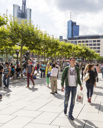 walking zone: FRANKFURT, GERMANY - AUGUST 9, 2014: people walk along the Zeil in Midday  in Frankfurt, Germany. Since the 19th century it is of the most famous and busiest shopping streets in Germany. Editorial