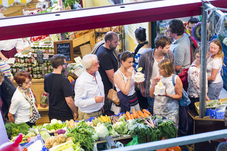 central market: FRANKFURT, GERMANY - AUGUST 9, 2014: people enjoy shopping in the Kleinmarkthalle in Frankfurt, Germany. The hall from 1954 is the most famous fresh food market in Frankfurt on 1500 SQ (m2).