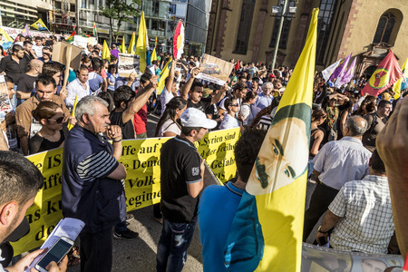genocide: FRANKFURT, GERMANY - AUGUST 9, 2014: people demonstrate against murder and violation of kurdish people and killing by IS soldiers in Frankfurt, Germany.