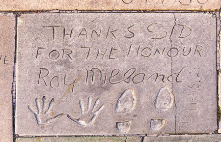 LOS ANGELES - JUNE 26, 2012:  handprints of Ray Milland in Hollywood Boulevard in Los Angeles. There are nearly 200 celebrity handprints in the concrete of Chinese Theatres forecourt.
