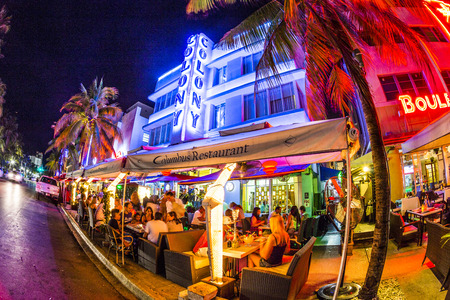 MIAMI, USA - AUG 19, 2014: people enjoy Ocean drive nightlife in  Miami, USA. Art Deco district architecture is one of the main tourist attractions in Miami.