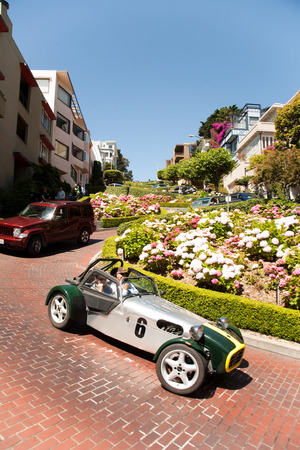 SAN FRANCISCO, USA : July 23: Oldtimer passing the lombard street on July 23, 2008 in San Francisco, USA. It is famous for having a steep, one-block section that consists of eight tight hairpin turns.