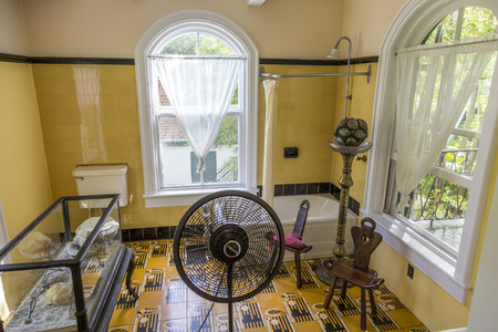 lived here: KEY WEST, USA - AUG 27, 2014: bath room of Ernest Hemingway in Key West, USA. Ernest Hemingway lived and wrote here from 1931 to 1939.