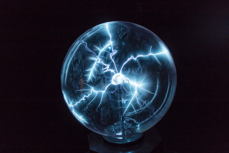 Electricity in a plasma ball as high voltage lightning photo
