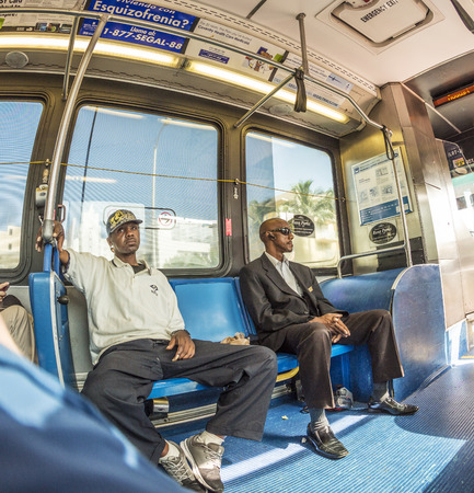 busses: MIAMI, USA - AUG 18, 2014: people in the downtown Metro bus in Miami, USA. Metrobus operates more than 90 routes with close to 1,000 buses covering 41 million miles per year.