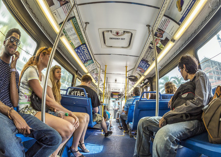 conditioned: MIAMI, USA - AUG 18, 2014: people in the downtown Metro bus in Miami, USA. Metrobus operates more than 90 routes with close to 1,000 buses covering 41 million miles per year.
