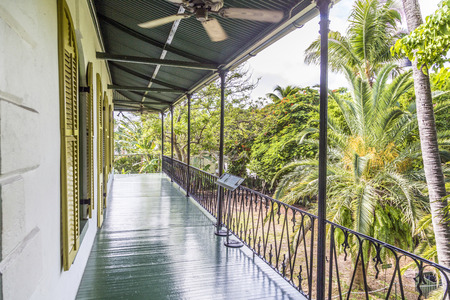 KEY WEST, USA - AUG 27, 2014: porch on the side of  Ernest Hemmingways house in Key West, USA. Ernest Hemingway lived and wrote here from 1931 to 1939.