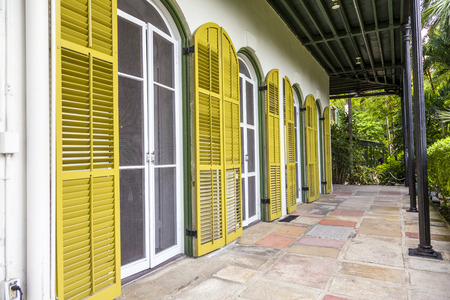 ernest: KEY WEST, USA - AUG 27, 2014: porch on the side of  Ernest Hemmingways house in Key West, USA. Ernest Hemingway lived and wrote here from 1931 to 1939.
