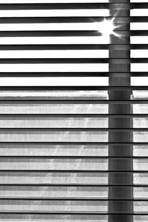 harmonic: shutter blind of a window in sunshine gives harmonic shadow