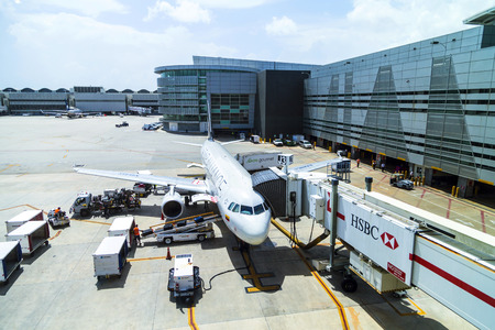 headquartered: MIAMI, USA - AUG 16, 2014: A TACA Embraer 190 in Miami, USA. TACA International Airlines is headquartered in El Salvador. They operate with 50 planes and carry 4 million passengers per year.