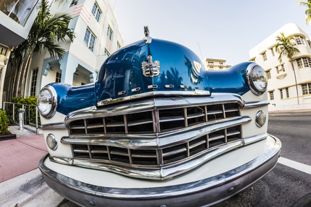 MIAMI, USA - AUG 18, 2014 : Dodge Vintage car parked at Ocean Drive in Miami Beach, Florida. Art Deco architecture in South Beach is one of the main tourist attractions in Miami