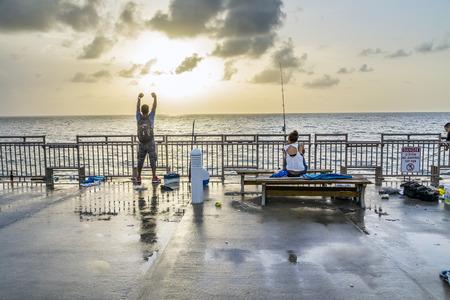 SUNNY ISLES BEACH, USA - AUG 17, 2014: people catch fishes at  the pier in Sunny Isles Beach, USA. In 1936, Milwaukee malt magnate Kurtis built the Sunny Isles pier.