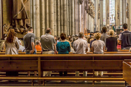 COLOGNE, GERMANY- SEP 7, 2014: church service held in the cathedral in Cologne, Germany. The dome is Germanys most visited landmark visited by 20.000 people a day. Éditoriale