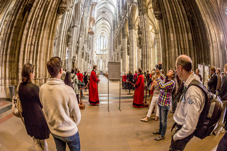 high altar: COLOGNE, GERMANY- SEP 7, 2014: church service held in the cathedral in Cologne, Germany. The dome is Germanys most visited landmark visited by 20.000 people a day. Editorial