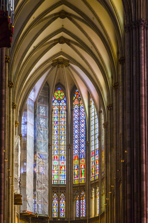 COLOGNE, GERMANY- SEP 7, 2014: Stained glass church window with St. Paul theme.The current window was reconstructed between 1992 and 1994. July 21, 2014 in Cologne