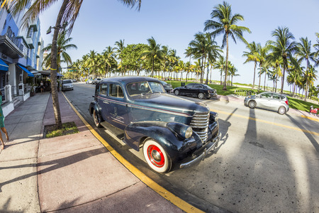 MIAMI, USA - AUG 19, 2014: classic Oldsmobile parks in front of the Hotel Park Central in Miami, USA. Built in 1937, The Park Central is known as The Blue Jewel of Ocean Drive.