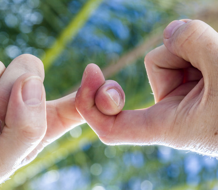 catenation: two fingers hooked in detail Stock Photo