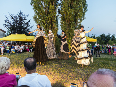 ESCHBORN, GERMANY - AUG 16, 2013: people on stilts perform Romeo and Juliet  wearing carnival costumes   in Eschborn, Germany. The summertime festival is a yearly event in Augusr.