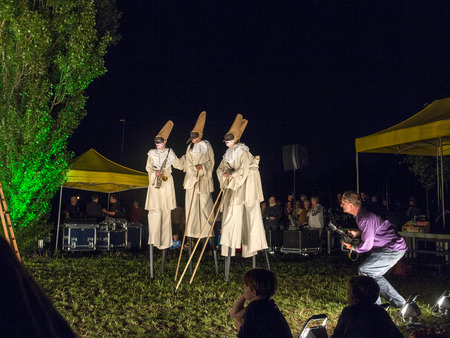romeo and juliet: ESCHBORN, GERMANY - AUG 16, 2013: people on stilts perform Romeo and Juliet  wearing carnival costumes   in Eschborn, Germany. The summertime festival is a yearly event in Augusr.