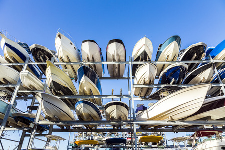 speed motor boats are stapled in a garage system in the prestigious harbor in Miami