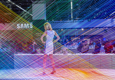 shootings: PHOTOKINA, COLOGNE - SEPTEMBER 19, 2014: models pose for visitors at  Photokina in Cologne, Germany. They pose for free shootings for visitors to test the new cameras. Editorial