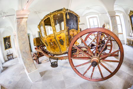 colden: FULDA, GERMANY - SEP 21, 2014:  carriage at the castle Fasanerie in Fulda, Germany. The golden carriage was used coach was used only for parades. Editorial