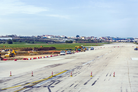 airport runway: LISBON, PORTUGAL - DEC 30, 2008: people repair runway of the airport in Lisbon, Portugal. Lisbon Portela Airport, is the main international gateway to Portugal and opened first in 1942. Editorial