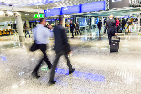 FRANKFURT, GERMANY-SEP 18, 2014: passengers at the departure hall in Frankfurt, Germany. With 38 million passengers per year it is one of the most important airport in Europe.