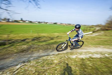 dirt bike: boy racing with his dirt bike Stock Photo