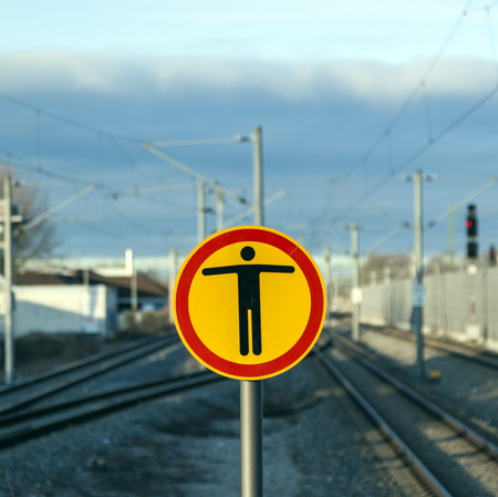 no way out: sign Beware of trespassing at train station under blue sky Stock Photo