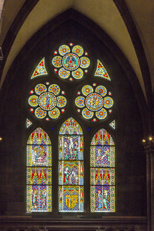 freiburg: FREIBURG, GERMANY - JULY 4, 2014: beautiful windows of the minster in Freiburg, Germany. The windows show religious scenes from the bible.