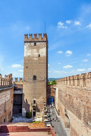 VERONA, ITALY - AUG 5, 2009: people visit Castelveggio in Verona, Italy. The castle stands on the probable location of a Roman fortress outside the Roman city and was built in 1354.