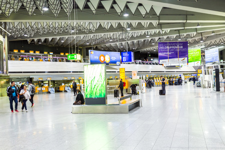 handled: FRANKFURT, GERMANY - SEP 22, 2014: people at the Airport in the evening in Frankfurt, Germany. In 2012, Frankfurt handled 57.5 million passengers.