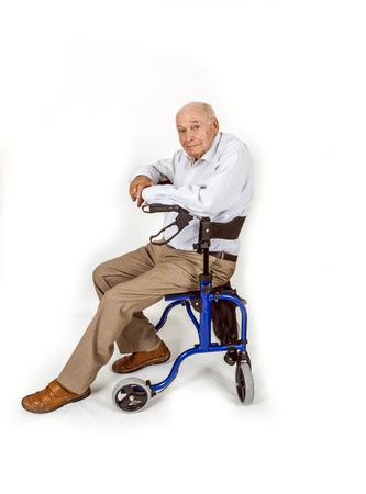 happy senior man with walking frame photo
