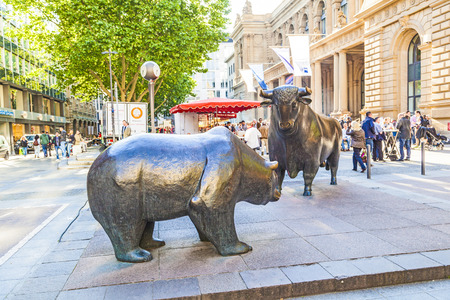 frankfurt stock exchange: FRANKFURT, GERMANY - MAY 16, 2014: The Bull and Bear Statues at the Frankfurt Stock Exchange in Frankfurt, Germany. Frankfurt Exchange is the 12th largest exchange by market capitalization. Editorial