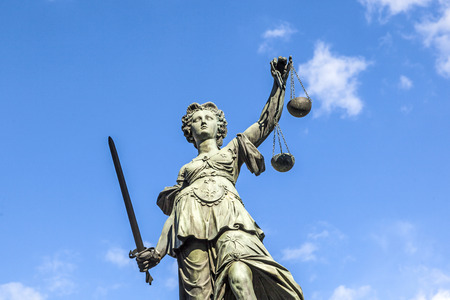 justice: Justitia (Lady Justice) sculpture on the Roemerberg square in Frankfurt, built 1887.