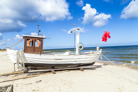 fishermans boat at the beach of the baltic sea photo