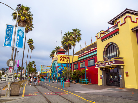 SANTA CRUZ, USA - SEP 21, 2014: people at Boardwalk in Santa Cruz, California. The Santa Cruz boardwalk, opened in 1907 and is the oldest amusement park in California.