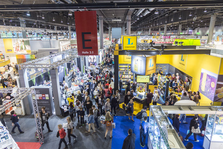 FRANKFURT, GERMANY - OCT 12, 2014 : public day for Frankfurt Book fair, visitors inside the hall in Frankfurt, Germany. The fair is open at the weekend for public. Éditoriale