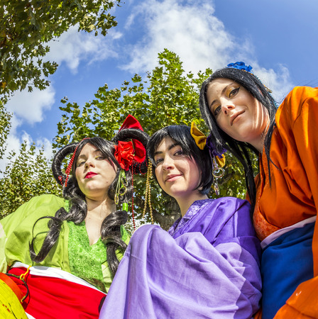 FRANKFURT, GERMANY - OCT 12, 2014: Public day at Frankfurt international Book Fair, colorful girls made up as Manga japanese style poses for photographers in Frankfurt, Germany.