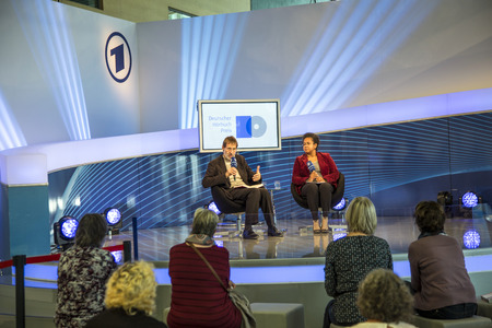 ard: FRANKFURT, GERMANY - OCT 12, 2014: Public day at Frankfurt international Book Fair, interview at ARD meeting point with Frank Arnold, winner of an audio book price in Frankfurt, Germany. Editorial