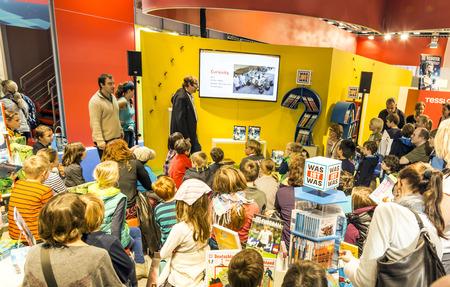 FRANKFURT, GERMANY - OCT 12, 2014: Public day at Frankfurt international Book Fair, moderator explains to children the curiosity roboter project in Frankfurt, Germany.