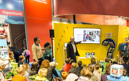 roboter: FRANKFURT, GERMANY - OCT 12, 2014: Public day at Frankfurt international Book Fair, moderator explains to children the curiosity roboter project in Frankfurt, Germany.