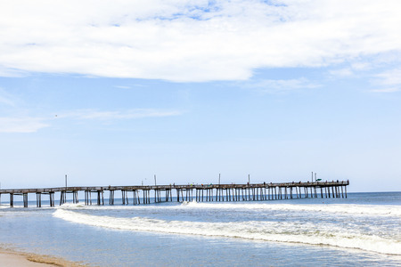 nags: beach with old wooden pier under blue sky