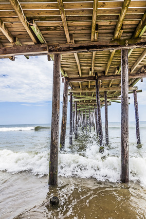 nags: beach with old wooden pier at Nags Head Stock Photo