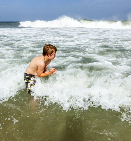 outerbanks: boy enjoys the waves of the beautiful sea Stock Photo